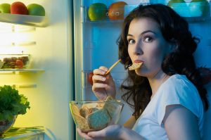 bigstock-a-hungry-girl-opens-the-fridge-36532972